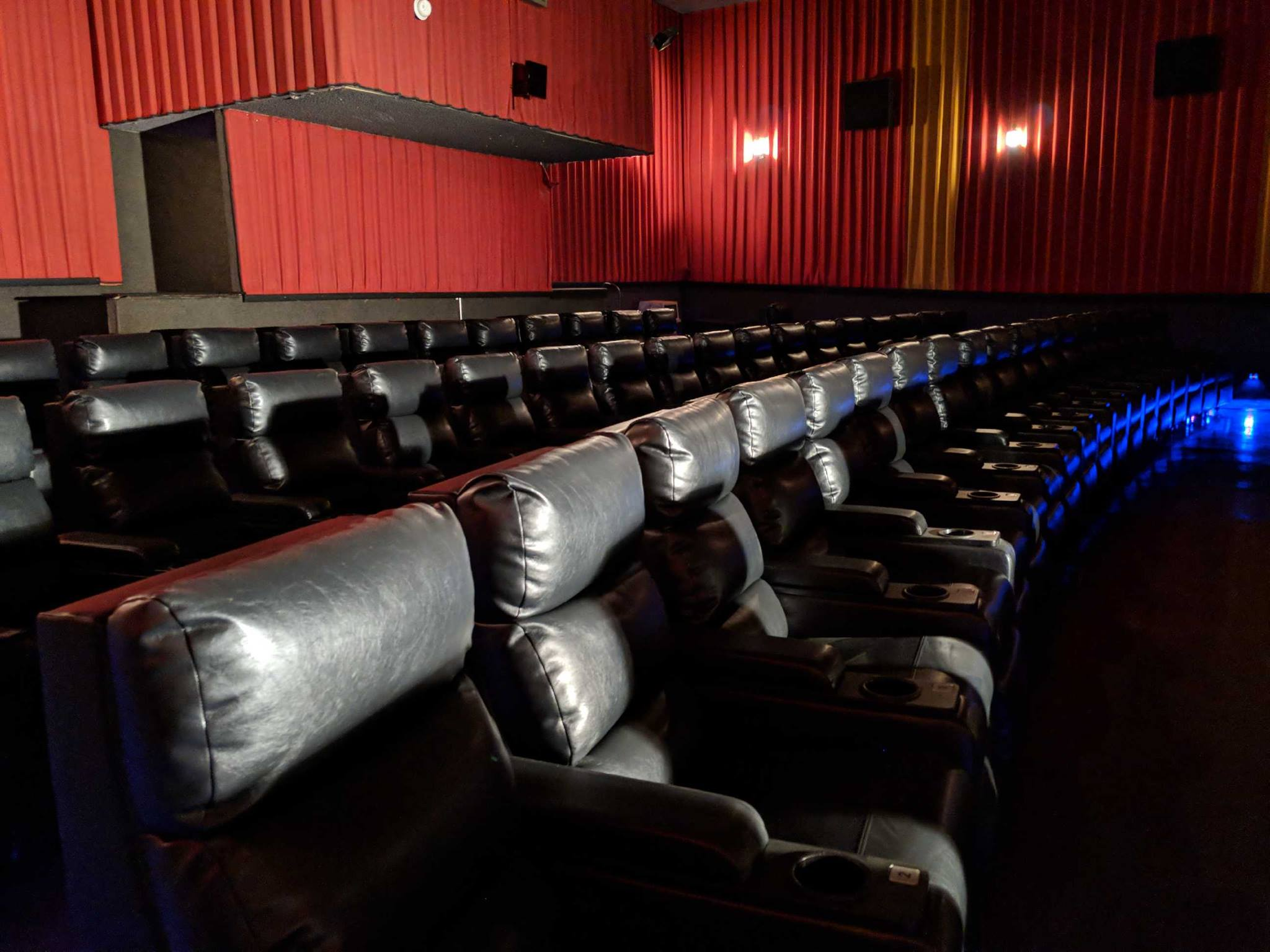 Theatre Amenities; 3 Hours free parking in garage behind theatre; DOLBY SURROUND ; Digital Projection; Huge wall to wall curved screens; Stadium seating with high back rocking chairs.