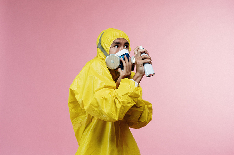 Man in Hazmat Suit with disinfectant